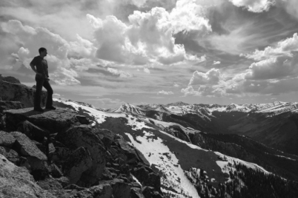 Picture of man looking out over mountain vista
